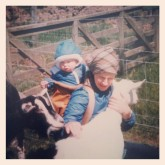 me as a baby with mum and goats