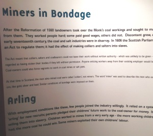 A museum panel on miners essentially being slaves