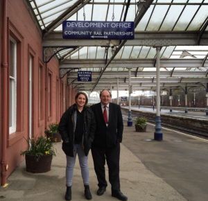 On the platform at Kilmarnock hearing about the community rail partnership and heritage group